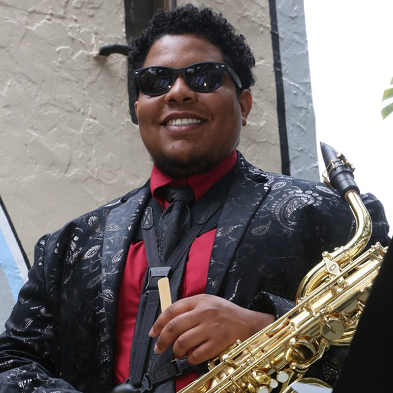 Tyler Johnson has a fun, soulful presence. His baritone sax low end is essential to the music style of The Convertibles.